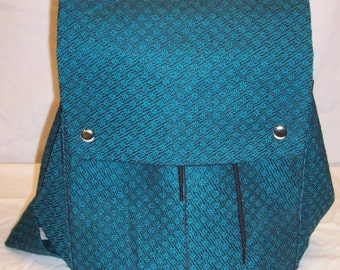 Clara Backpack in Turquoise and Black Upholstery Fabric with a Small Floral Pattern and a black canvas duck lining