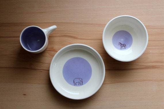 child's pottery set.  african animals, purple.