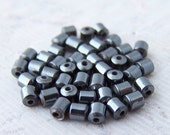 50 - Itsy Bitsy Teeny Weeny Adorable Hematite Tube Beads
