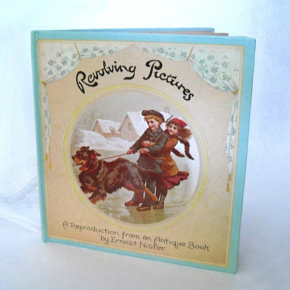 vintage victorian antique  revolving pictures book by Ernest Nister circa 1892 a reproduction - Copyright 1979