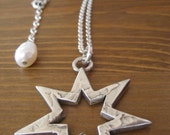 Molten Solid Silver 7-Pointed Star