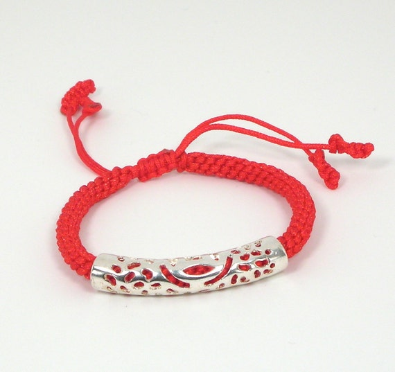 The Mysterious Simplicity of a Red String Bracelet