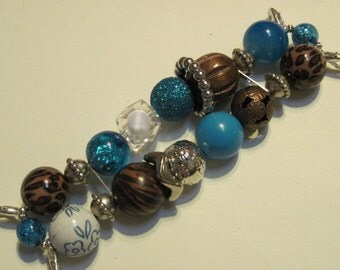 Chunky blue, brown, cheetah print, white, clear and silver plated acrylic beaded interchangeable watch band
