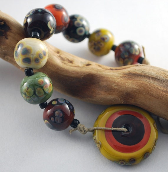HARVEST rounds and disc set - 8 multicoloured glass bead rounds and one large disc.