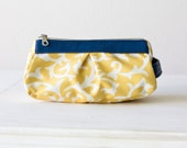 Cosmetic pouch in yellow floral cotton and blue leather