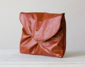 Large leather clutch in Burnt Orange