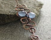Solid copper shawl pin in snake shape wrapped with lavender blue chalcedony briolette and pin stick