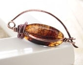 Solid copper shawl pin with wrapped espresso brown scaled oval shaped agate