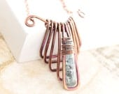 Egyptian design geometrical copper necklace with wrapped organic kyanite stone