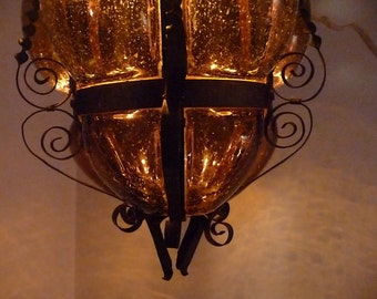 beautiful spanish mid century iron and amber glass light