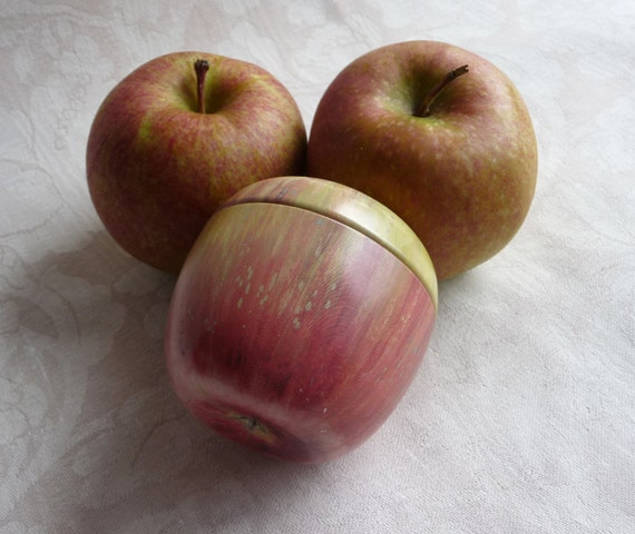 One of these is not a real apple - it's a vintage tin