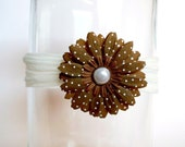 Pretty brown flower with large pearl center on a cream headband