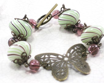 Alexandra - Vintage Style Blown Glass bracelet striped glass purple green with butterfly
