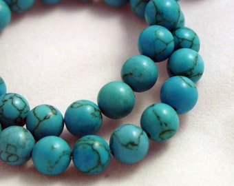 16 inch strand of turquoise colored stone beads