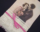 Vintage lace on tag with antique postcard copy and ribbon