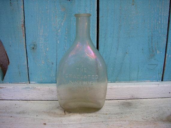 Antique Bottle - Iridescent - The Graduated Nursing Bottle - Circa 1890 to 1910's Flared Lip Bottle