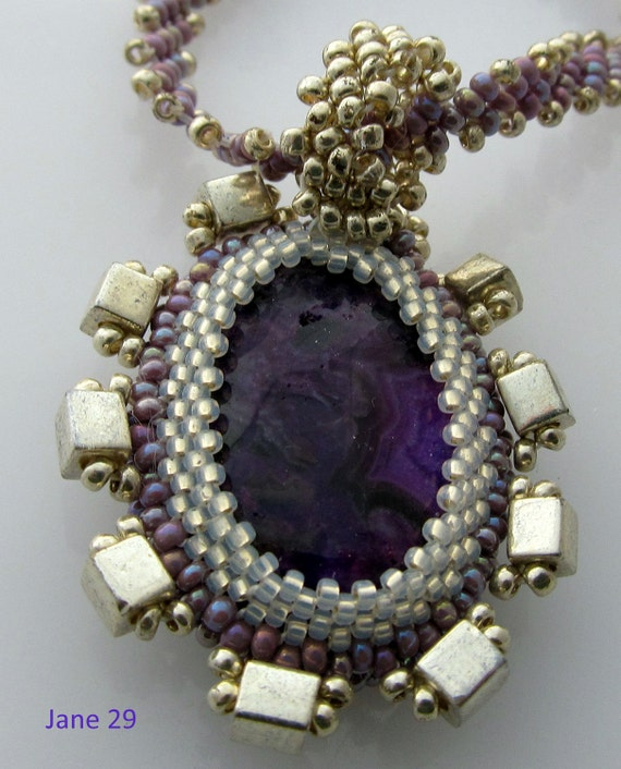 Purple Crazy Lace Agate with Beadweave Bezel of Seed Beads and Metalic Silver Cubes on a St Petersburg Lavender Beadwoven Rope