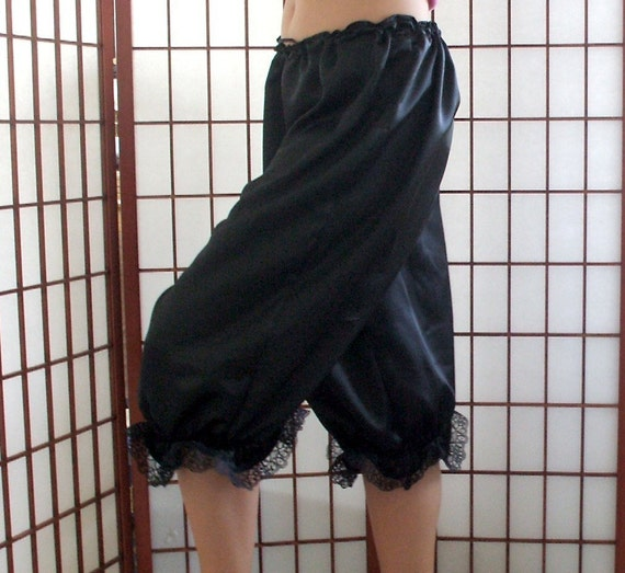 Red satin bloomers with shiny black skulls