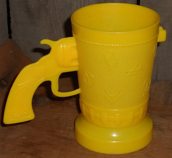 western theme yellow plastic cup with gun handle and branding