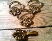 SALE. lot of 4 Drawer Pulls. 3 matching plus 1 extra. Vintage brass handles with scroll design.