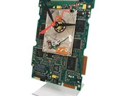 Apple iPod Hard Drive Clock on a Circuit Board all recycled, very cool stuff.
