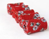 Hand rolled fiber beads in floral red  printed cotton