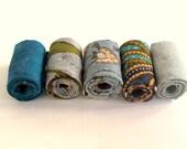 Hand rolled artisan fiber beads in smoke blue , teal and batik printed cotton