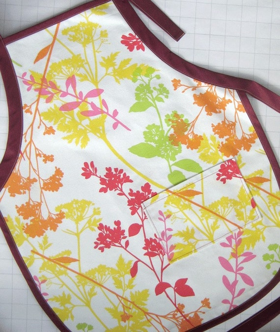 Wildflower student apron in pink, red, orange, yellow & lime