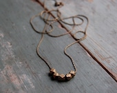 Long hand cast brass necklace