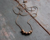 Long hand cast brass necklace