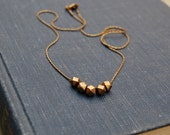 Hand cast brass necklace