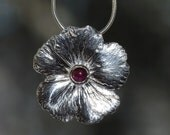 Silver flower pendant with ruby. Single flower necklace, genuine ruby. July birthstone.