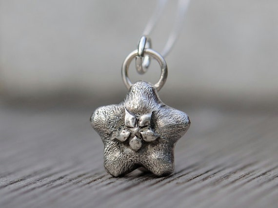 Sterling silver flower necklace. Antiqued wax flower pendant with sterling silver box chain.