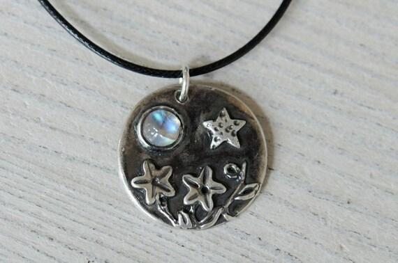 Rainbow moonstone silver necklace. Coin pendant. Night garden. Black waxed cotton cord.