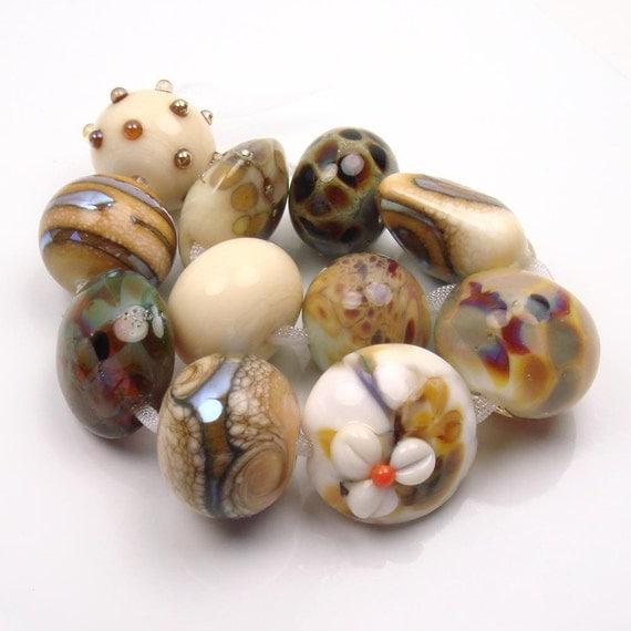 Handmade lampwork orphan beads  in  Creams, loose glass beads