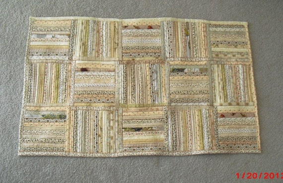 Cotton throw rug -- neutral shades of tan, beige, off-white
