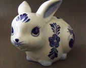 looking after your money with a very big smile  delft rabbit money box