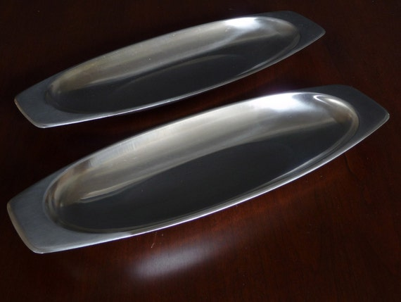 Two long stainless steel trays