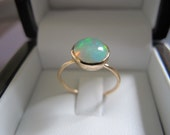 Arc en ciel Collection round cabochon Welo opal ring set in 18K solid gold. Size 6.5