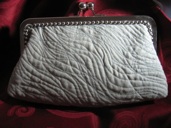 "gray clutch linen   8"" kiss frame..9"" across bottom Ashley is savvy.."