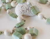Green necklace with fossil glass