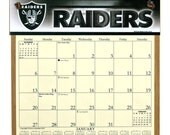 2016 CALENDAR - Oakland Raiders Wooden  Calendar Holder filled with a 2016 calendar & a refill order form page for 2017.