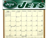 2016 CALENDAR - New York Jets Wooden  Calendar Holder to Canada filled with a 2016 calendar & a refill order form page for 2017.