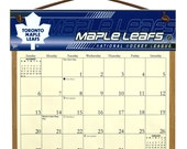 2016 CALENDAR - Toronto Maple Leafs Wooden  Calendar Holder filled with a 2016 calendar & a refill order form page for 2017.