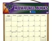 2016 CALENDAR - Milwaukee Bucks Wooden  Calendar Holder filled with a 2016 calendar & a refill order form page for 2017.