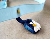 Miss Daisy Choker hand painted polymer clay pendant sewn onto blue ribbon