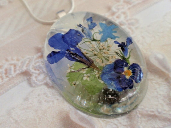 Blue Butterfly Garden-Oval Resin Real Pressed Flower Pendant with Purple-Blue Pansy,  Blue and  White Lobelia, Queen Anne's Lace, Ferns
