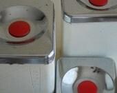 vintage - Mid Century distressed set of metal canisters