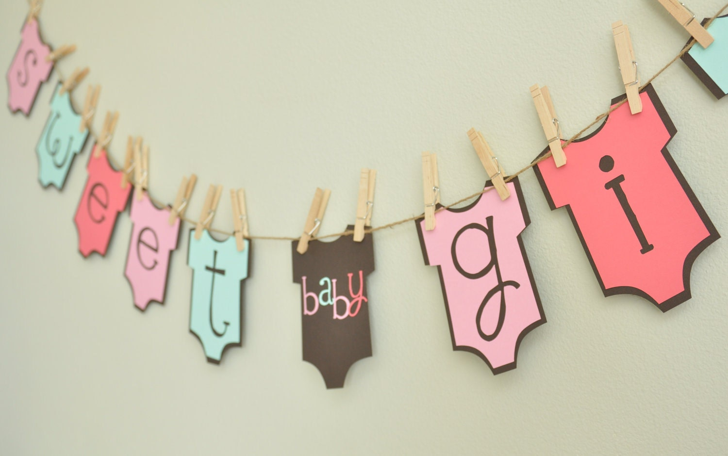Baby girl onesie banner baby shower onesie theme baby girl for Baby name decoration ideas