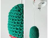 Hand crocheted pendant lamp dark green with coral/white accent. Unique design